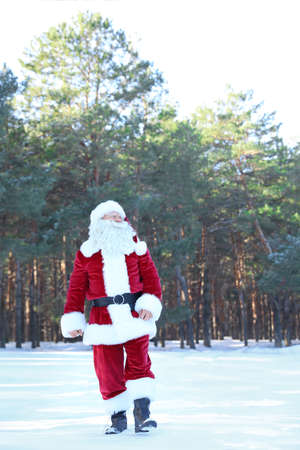 Happy Authentic Santa Claus walking outdoors. Space for text