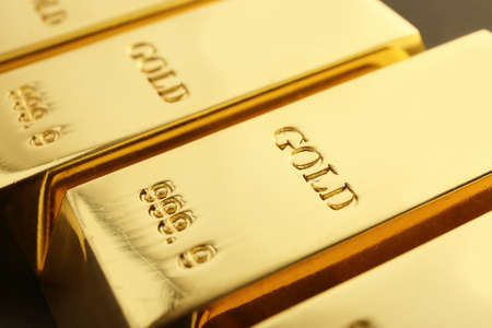 Shiny sleek gold bars as background, closeup