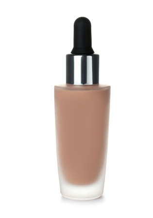 Bottle of skin foundation on white background
