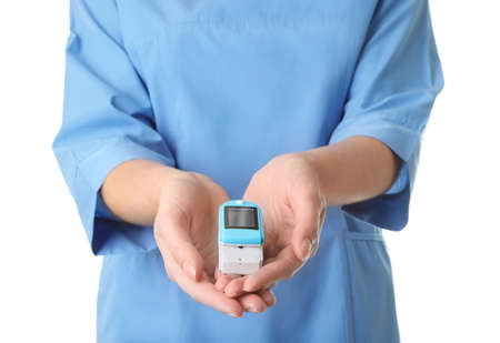 Female doctor holding heart rate monitor on white background, closeup. Medical object 版權商用圖片