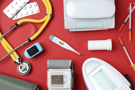 Flat lay composition with different medical objects on color background