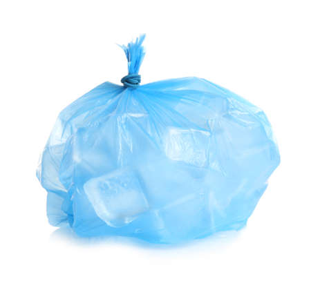 Plastic bag with ice cubes on white background