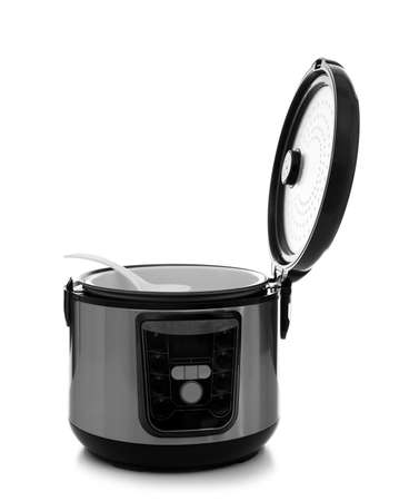 Modern electric multi cooker with spoon on white background