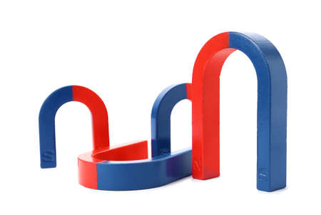 Red and blue horseshoe magnets isolated on white