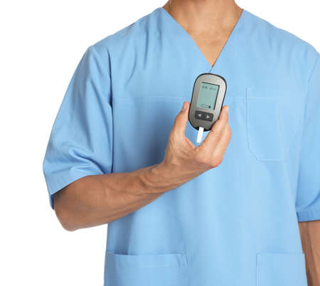 Male doctor holding glucose meter on white background, closeup. Medical object