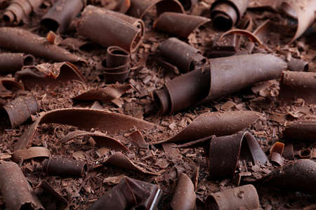 Yummy chocolate curls for decor as background, closeup Stock fotó