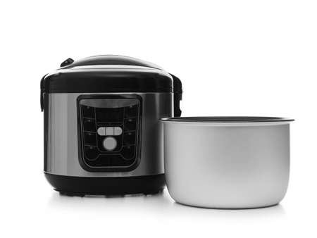 Disassembled electric multi cooker on white background