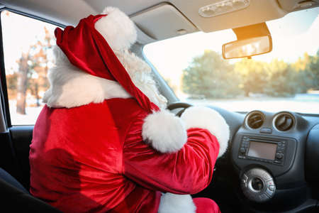 Authentic Santa Claus driving car, view from inside Stock Photo