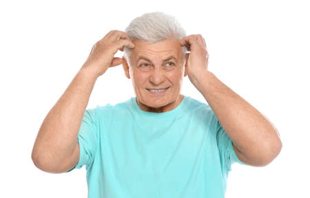 Mature man scratching head on white background. Annoying itch