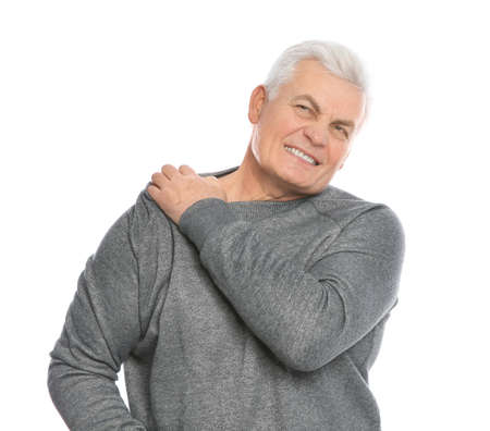 Mature man scratching shoulder on white background. Annoying itch