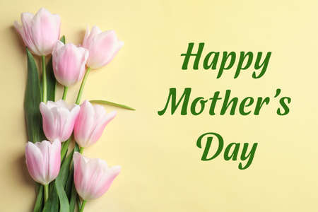 Beautiful tulips and text Happy Mothers Day on yellow background, top view