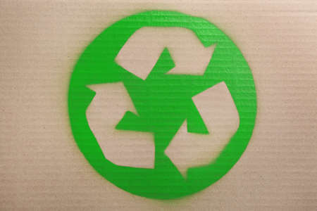 Recycling symbol painted on cardboard, top view Stock Photo