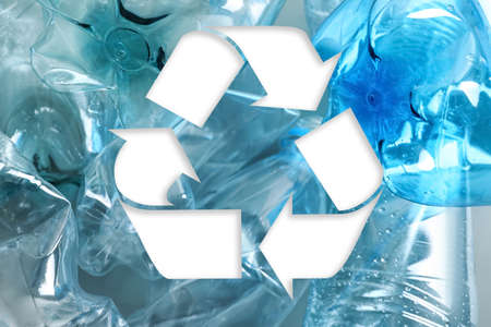 Symbol of recycling and plastic bottles, closeup Archivio Fotografico