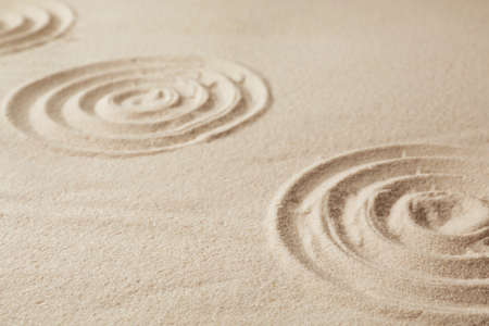 Zen garden pattern on sand. Meditation and harmony Фото со стока