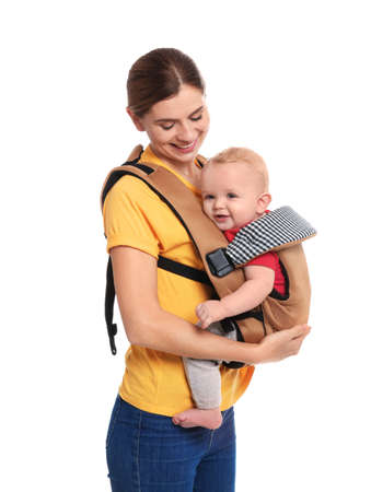 Woman with her son in baby carrier on white background Stockfoto