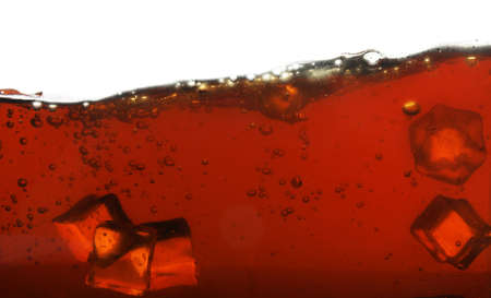 Closeup view of tasty refreshing cola with ice cubes on white background