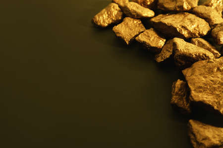 Pile of gold nuggets on color background. Space for text