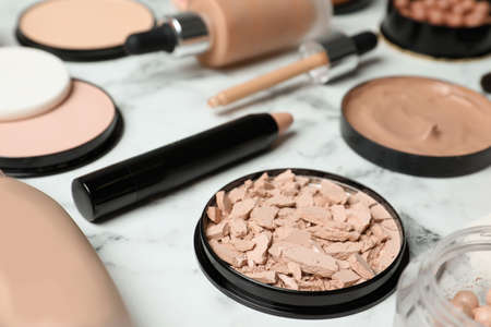 Composition with skin foundation, powder and beauty accessories on marble background Stok Fotoğraf