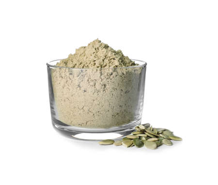 Bowl of fresh pumpkin seed flour and kernels isolated on white