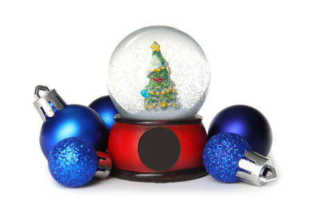 Magical snow globe with Christmas balls on white background 写真素材