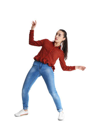 Young woman attracted to magnet on white background