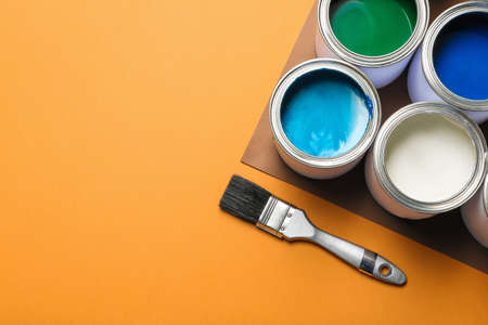 Flat lay composition with paint cans and space for text on color background Standard-Bild - 116294734