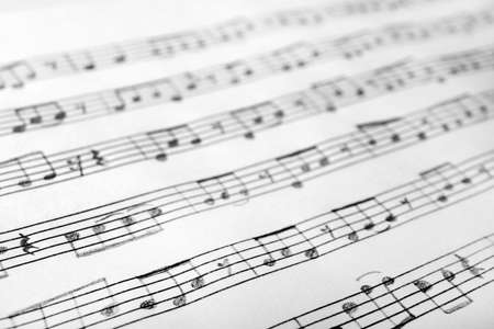 Sheet with music notes as background, closeup