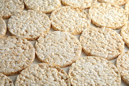 Crunchy rice cakes on white wooden background