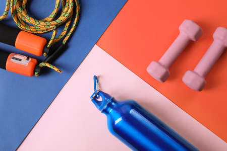 Flat lay composition with fitness gym equipment on color background Reklamní fotografie