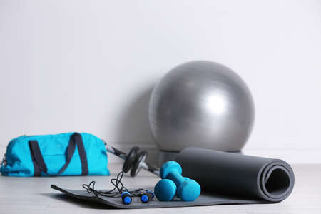 Set of fitness equipment on floor indoors
