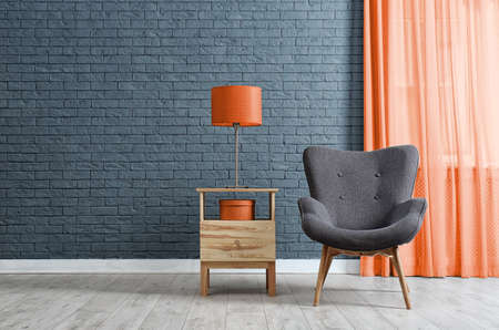 Stylish living room interior with orange elements. Space for text
