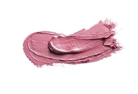 Pink lipstick smear on white background. Cosmetic product