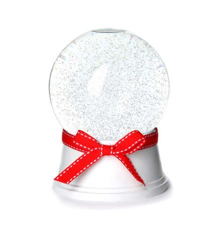 Magical empty snow globe with red bow isolated on white Stock Photo