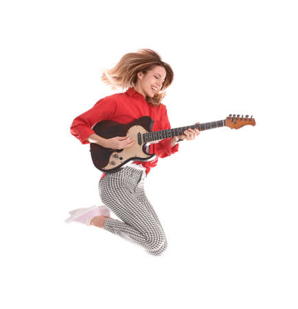 Young woman playing electric guitar on white background
