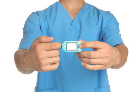 Male doctor using heart rate monitor on white background, closeup. Medical object
