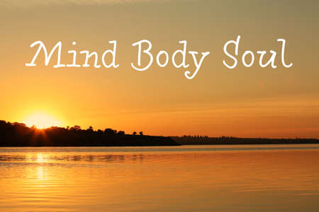 Picturesque view of beautiful riverside on sunset and text Mind, Body, Soul. Zen practice 写真素材