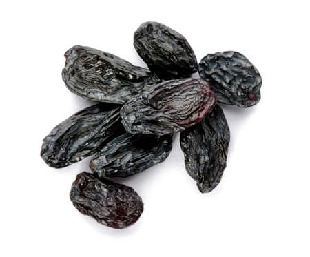 Tasty raisins on white background, top view. Healthy dried fruit