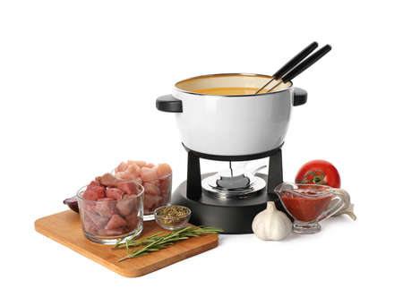 Composition with fondue pot and meat on white background