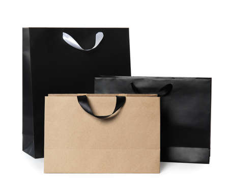 Paper shopping bags isolated on white. Mock up for design