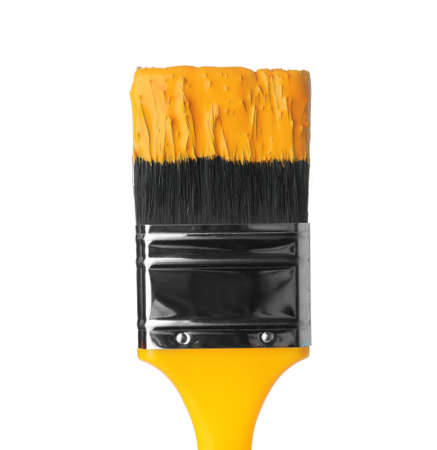 Brush with yellow paint on white background