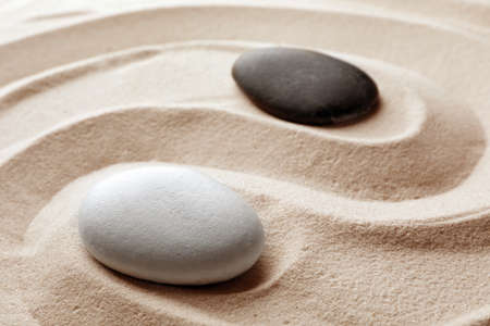 Zen garden stones on sand with pattern. Meditation and harmony