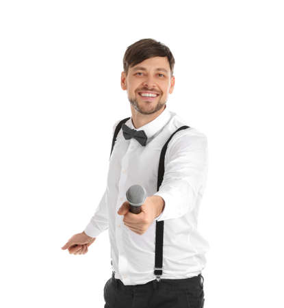 Handsome man in formal clothes with microphone on white background Stock Photo