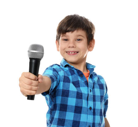 Cute little boy with microphone on white background