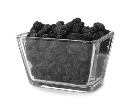 Bowl with raisins on white background. Healthy dried fruit