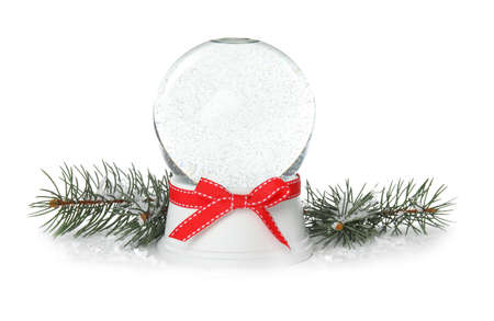 Magical empty snow globe with Christmas branches on white background