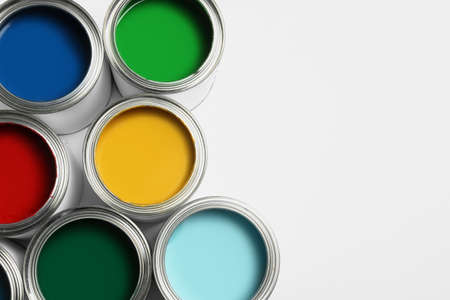 Open paint cans on white background, top view. Space for text Standard-Bild - 116639278