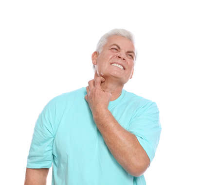 Mature man scratching neck on white background. Annoying itch Stock Photo