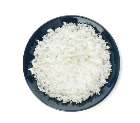 Plate of boiled rice on white background, top view