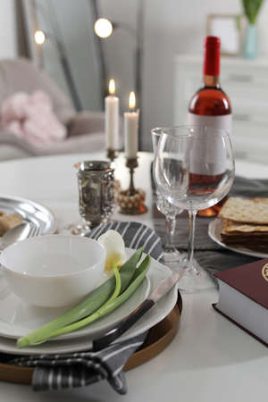 Festive Passover table setting at home. Pesach celebration Stock Photo