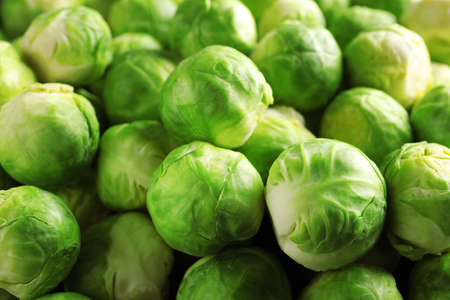 Pile of fresh Brussels sprouts as background